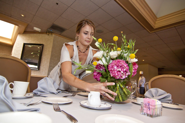 Sister Placing Centerpieces on Tables - Photo By: Logan Hall