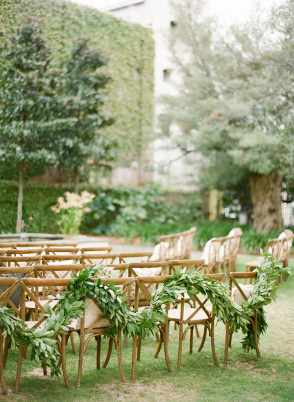 Garland Draped Across Chairs for Fresh Ceremony Decor